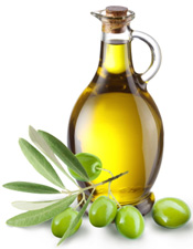 Elidia-female-chef-holding-a-bottle-of-olive-oil